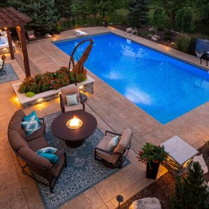 Fire Pit by the Swimming Pool | Fire Pit Ideas Outdoor Living | Alexander and Xavier Masonry
