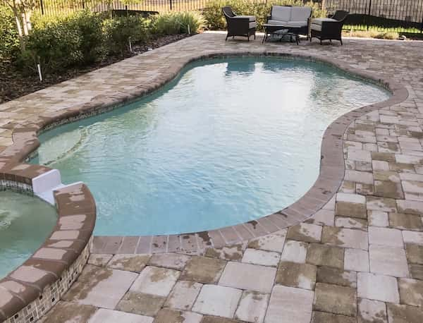 Pros and Cons Of Different Pool Paving Types And Materials | Alexander and Xavier Masonry