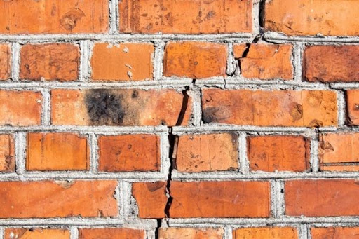 What Can You Do to Fix Cracks Over Your Garage Door Cracks above your garage door   Alexander and Xavier Masonry