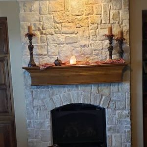 stone fireplace with floating Shelves | Alexander and Xavier Masonry